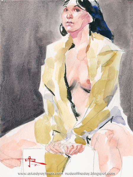 Kai In A Tan Trench Coat, Seated, Leaning Forward Onto Her Arms